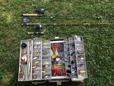 Fishing poles and vintage tackle box and lures