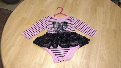 Onesie with tutu size 3/6 months would be very cute with a pair of leggings