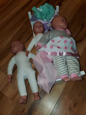 18 inch baby doll lot...3 baby dolls ..bed..diaper bag...bottle and several outfits