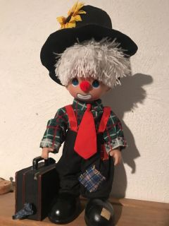 12 in precious moments doll with suitcase.