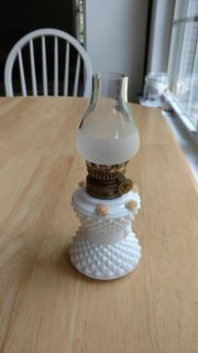"""Small white oil lamp measures 7"""" tall"""