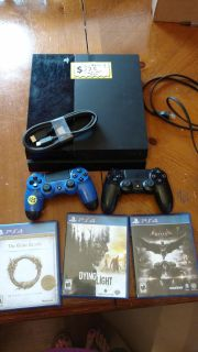 Play Station 4, 2 controllers and 3 games. PRICE IS FIRM