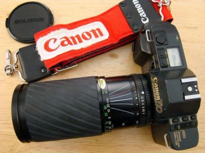 Cannon T70 SLR with a 600 zoom lens +cannon strap