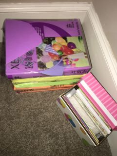 Stack of paper and box of cards