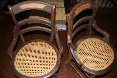 2 chairs with caned bottoms