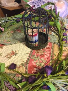 Rustic wire birdcage with painted wooden spool
