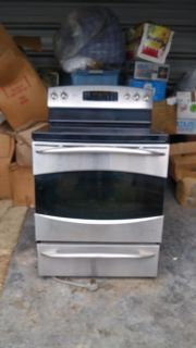 Gently used GE Profile glass top stove and convection oven with broiler