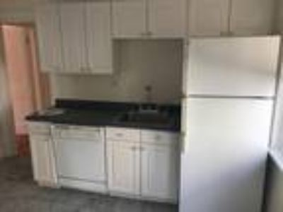 This great Two BR, One BA sunny apartment is located in the West Somerville area