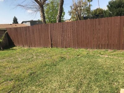 Wood Fence 83 feet long and 6 feet high FREE
