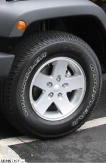 For Sale: Factory 18 alloy jeep wheels/tires