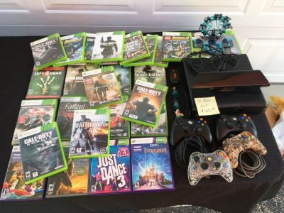 Xbox 360 w/kinect, 4 controllers and 26 games