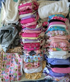 Lot of girls cloth diapers and extras