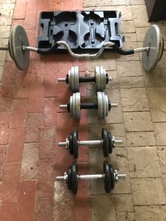 175 lb of interchangeable free weights with bar and dumbbell
