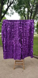 Beautiful purple curtains and rod