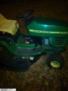 For Trade: Jon deer riding lawn mower trade for?