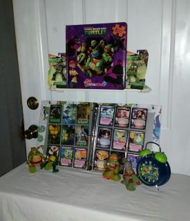 Ninja Turtle 14 trading cards and 18 2003 Dragon Ball 2 Trading Cards in Turtle Notebook, puzzle erasers, 4 figures, 4 complete puzzle book.