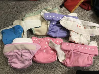 Lot of assorted cloth diapers with inserts baby kicks rumperoo etc.