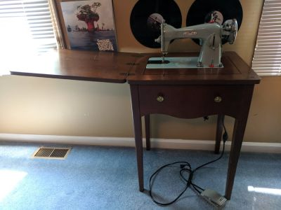 Antique sewing machine with stand