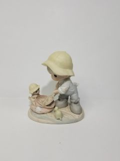 """Precious Moments Figurine """"Nothing Can Dampen The Spirit Of Caring"""""""