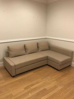 Tan sleeper couch with storage