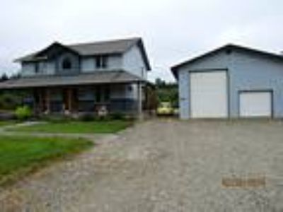 Acreage & home close to town with large shop