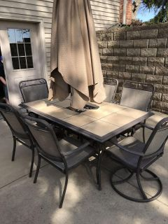 Patio Table with 6 Chairs and Umbrella $325
