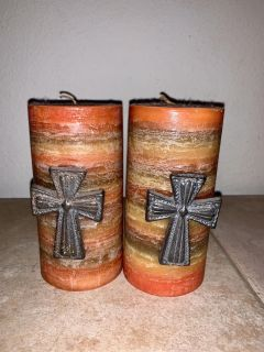 A set of candles w/crosses