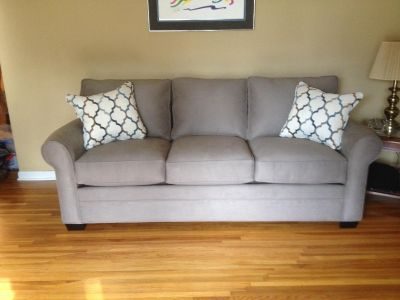 Grey couch 1 yr old and 2 decorator pillows