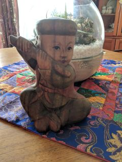 Antique wood carved statue