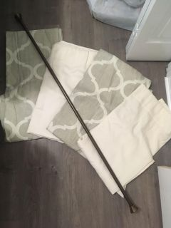 Curtain panels and curtain rod.