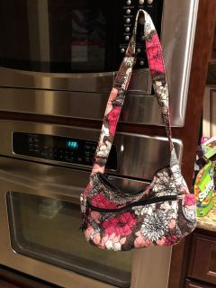 Mocha Rogue Vera Bradley purse. Good condition. Three pockets on the inside, and one on each side on the outside