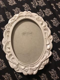 White oval picture frame