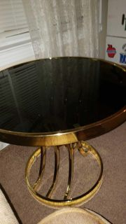 Two glass top tables moving soon