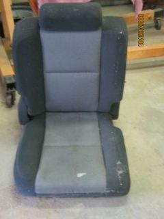 rear seat out of 4 door gmc truck