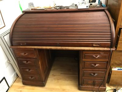 Antique wood writing desk with roll-top