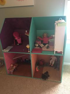 Adorable Wooden Dollhouse for an 18 inch doll. (Contents are not included) Has painted rooms, two built in corner shelves.