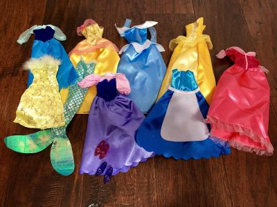 Lot of Barbie doll dresses and shoes