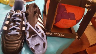 Brand new 7 1/2 soccer shoes & ball