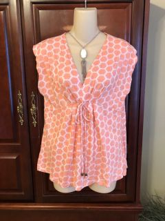 15.00size large Michael Kor s coral and white print top. It s ties in front with signature MK ends on the ties.