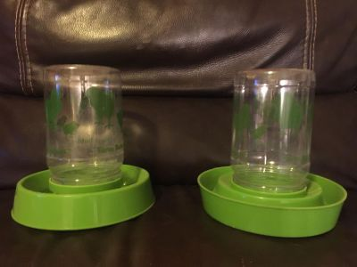 Two chicken or duck feeders