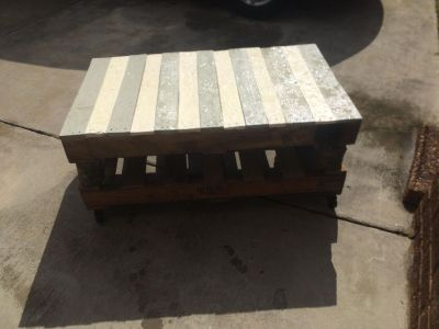 Pallet coffee table on rollers