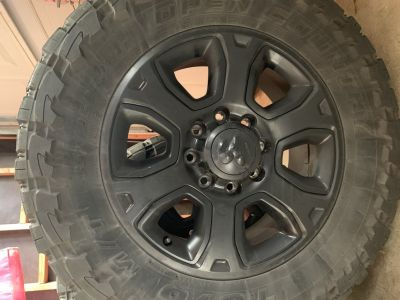 Dodge Ram 2500 Factory Black 20x8.5 Wheels with Toyo M/T 35/12.50R20