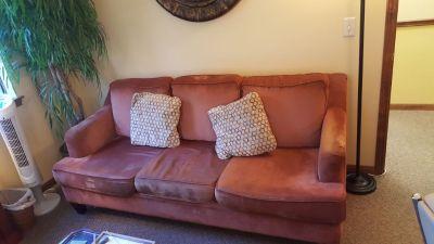 Burnt orange Havertys couch