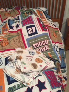 Twin sports comforter, sheets and lamp