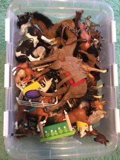 Tote full of toy horses