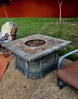 Firepit Table. Large, heavy. Chipped corner. Hole. As is.