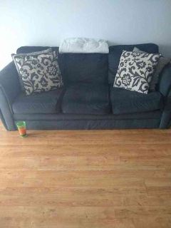 Gray couch with 4 pillows