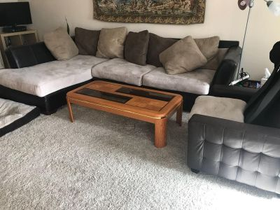 Brown and tan couch with 2 chairs and 2 low stools