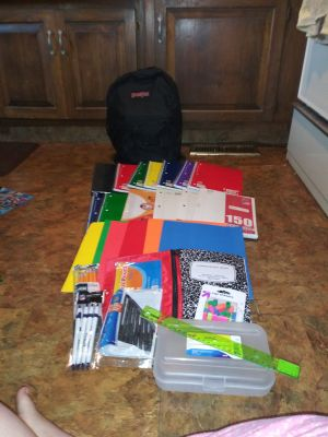 New backpack with assorted new school supplies