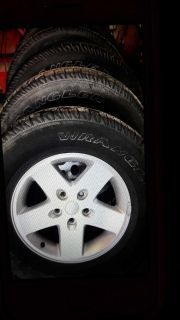"""(4) 17 """" jeep wrangler rims and tires"""